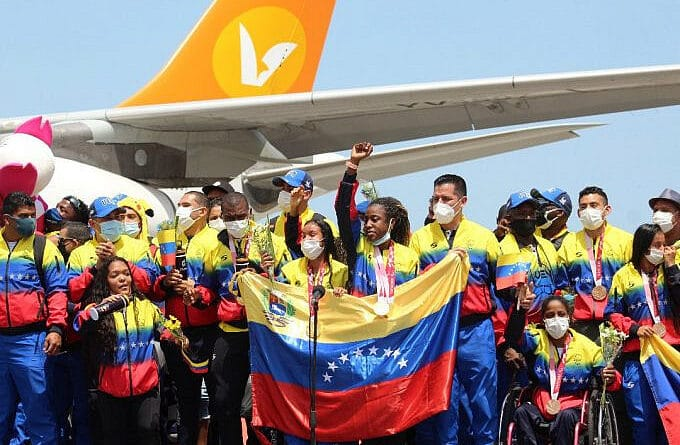 Venezuelan Paralympic athletes being received as heroes. Lisbeli Vera the top medalist in front of the mic. Photo courtesy of Conviasa.