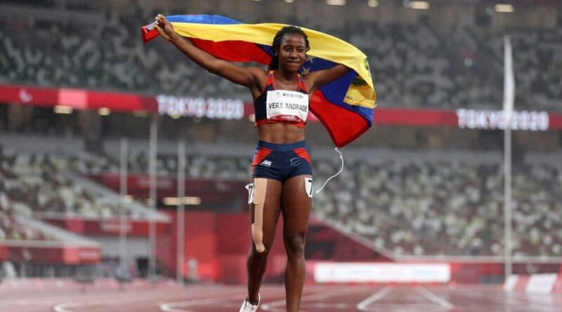 Lisbeli Vera holding the Venezuelan flag after wining her third Paralympic medal Tokyo 2020. Photo courtesy of Getty Images.
