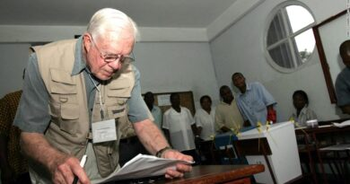 President Carter checking his notes while observing a polling station in Maputo, Mozambique, in December 2004. Since 1989 the Carter Center has been observing elections worldwide. Photo courtesy of CNN.