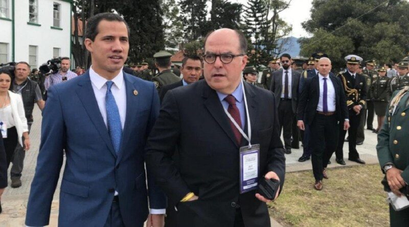 Former deputy Guaido following Julio Borges during an event with Colombian authorities, complicit like them in the looting of Monomeros. File photo courtesy of Caraota DIgital.