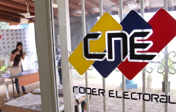 Door with a CNE logo and people working in the background. File photo.